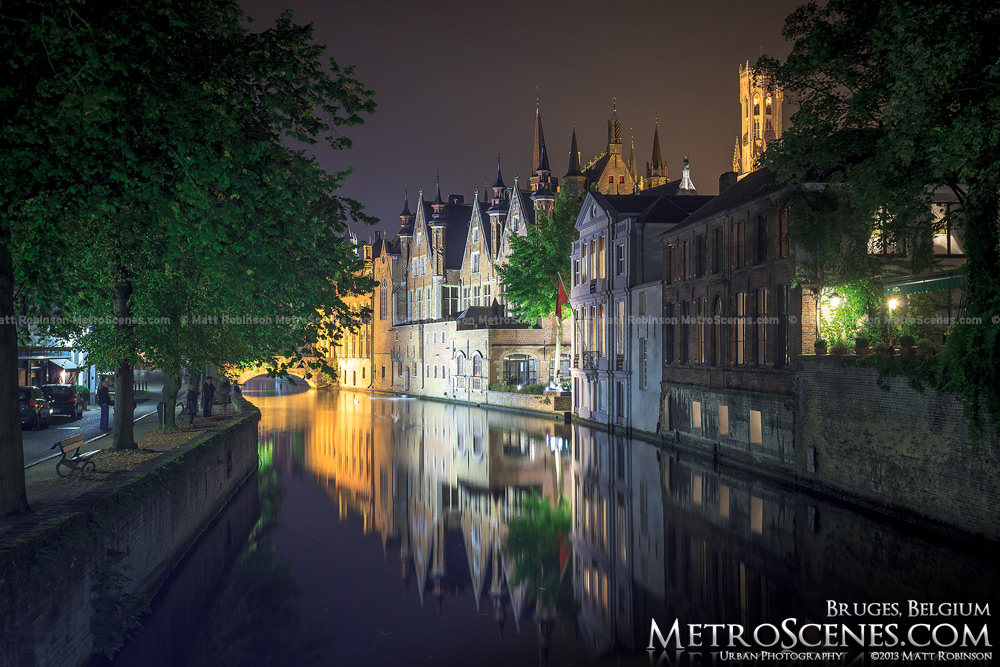 Reflections at Groenerei Canal at night in Bruges, Belgium