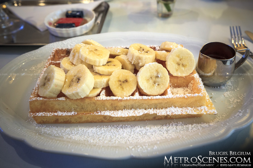 Authentic Belgian waffle with bananas at a cafe in Bruges, Belgium