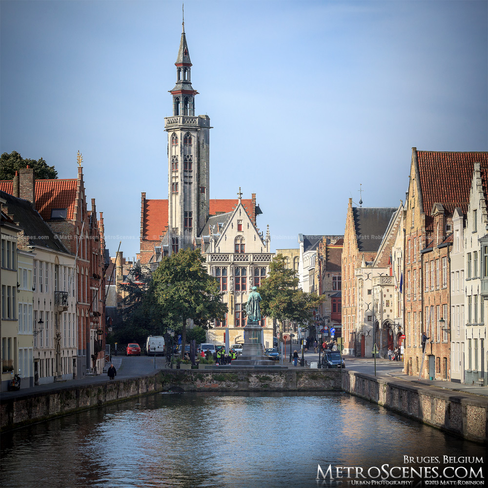 The Poortersloge and Jan van Eyck Statue at the end of Spiegelrei Canal in Bruges, Belgium