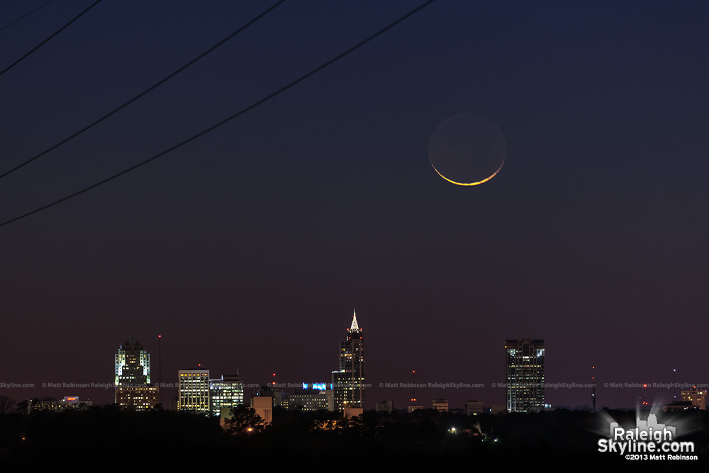 Crescent moon sets over the downtown Raleigh