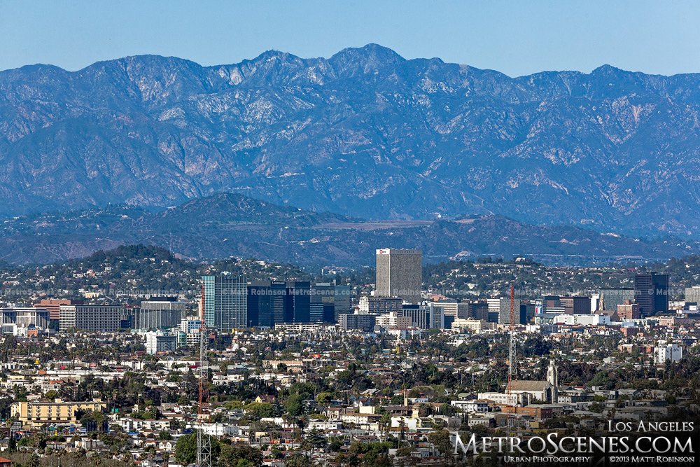 San Gabriel Mountains rise behind the buildings of Koreatown in LA