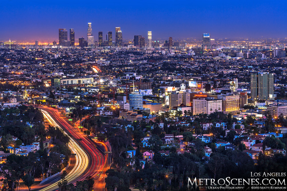 Traffic snakes along with the Hollywood Freeway with Los Angles skyline