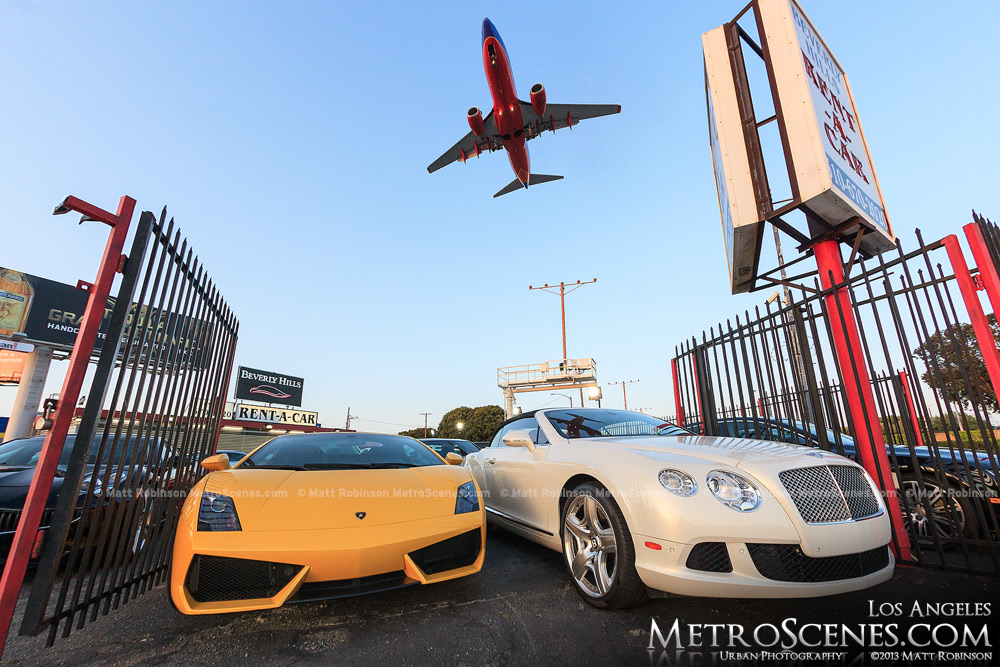 Southwest plane on approach at LAX with Bentley and Lamborghini