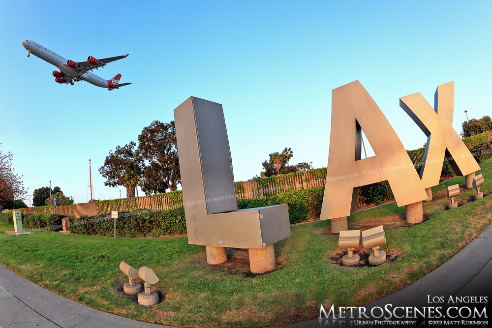 Virgin Airways A340-600 lands over the LAX sign at Los Angeles International