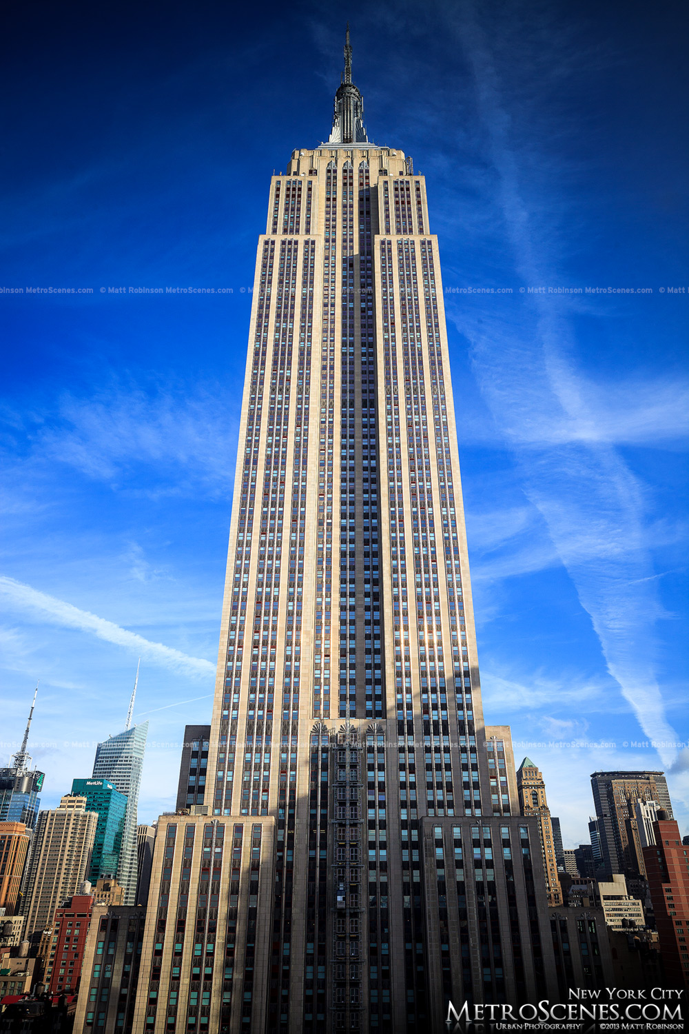 Blue sky and contrails with the Empire State Building