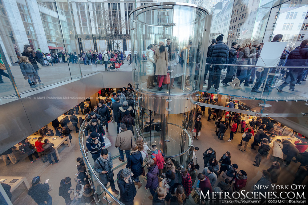 Hundreds of people browse the NYC Apple Store on Fifth