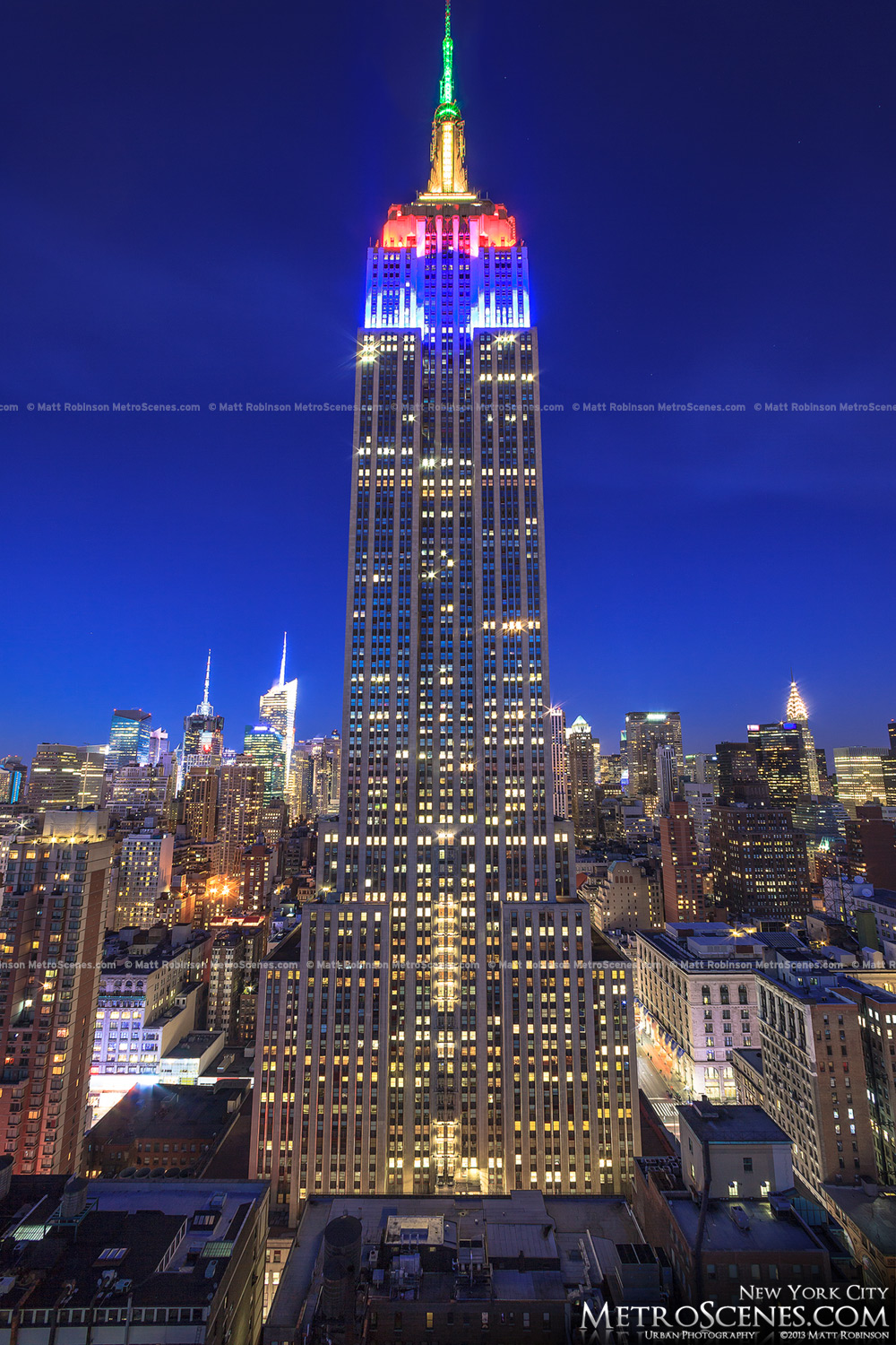 Looking up at the Empire State Building at night