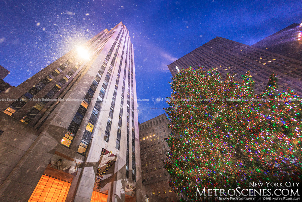 Snow falling with Rockefeller Center and Christmas Tree