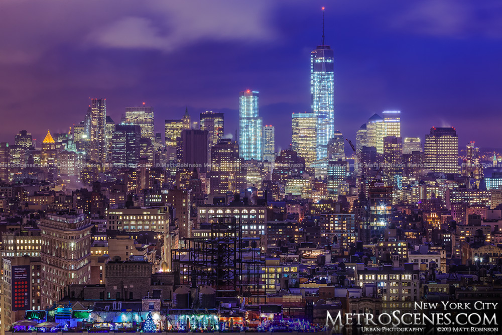 Downtown Manhattan with low clouds at night