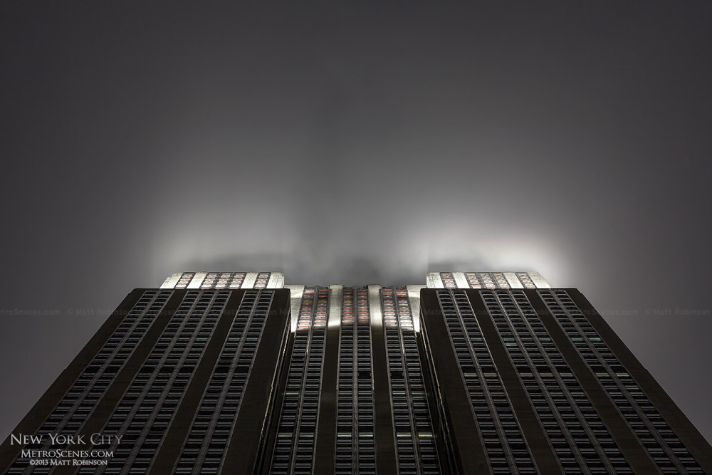Looking up at the Empire State Building in the fog