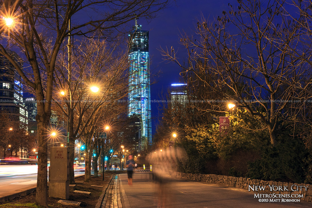 Hudson River Greenway Joggers at night with One World Trade Center