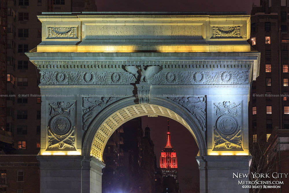Yellow-lit Washington Square Arch with Red Empire State building