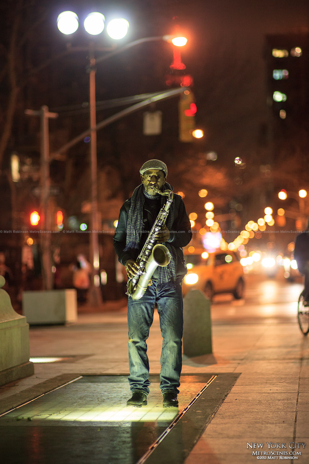 Saxophone player playing jazz at Washington Square Park at night