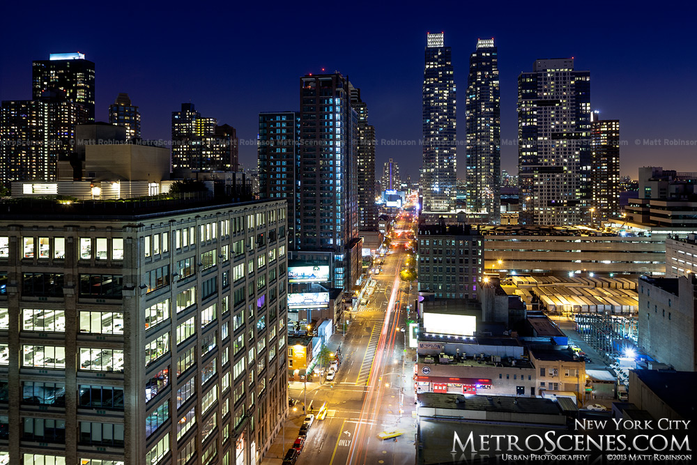 Looking down Eleventh Avenue and the Silver Towers at night in New York