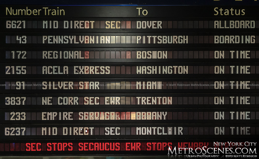 Train schedule board in Penn Station