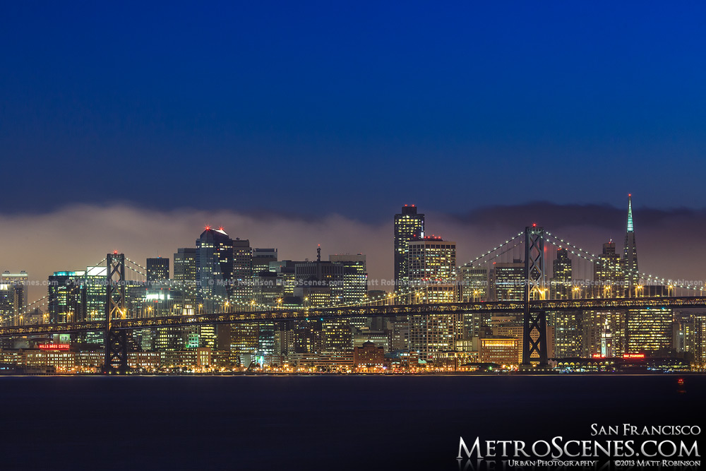 Fog seen behind San Francisco Skyline and Bay Bridge
