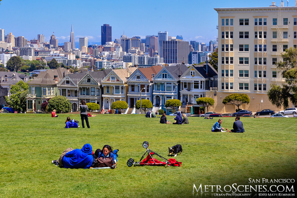 People enjoying the weather in Alamo Square