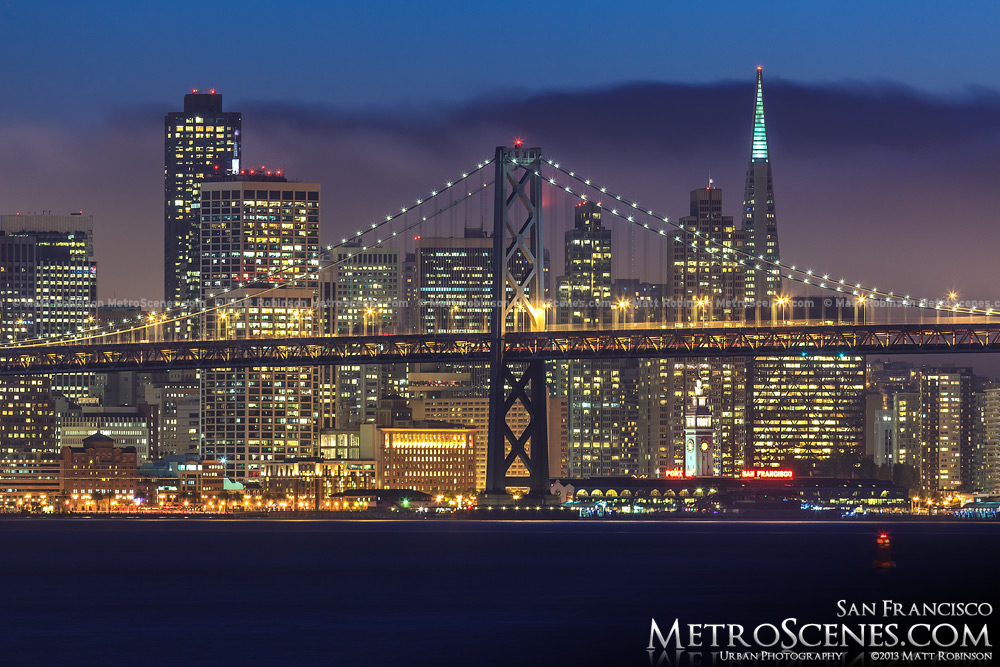 San Francisco at night with the Bay Bridge