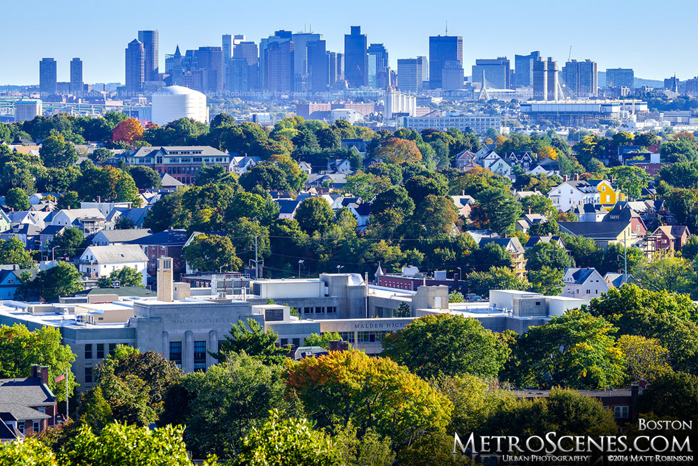 Downtown Boston Skyline over fall colors in Malden