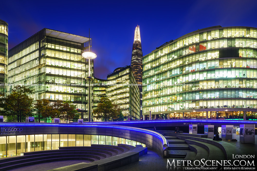 The buildings of More London at night with the Shard