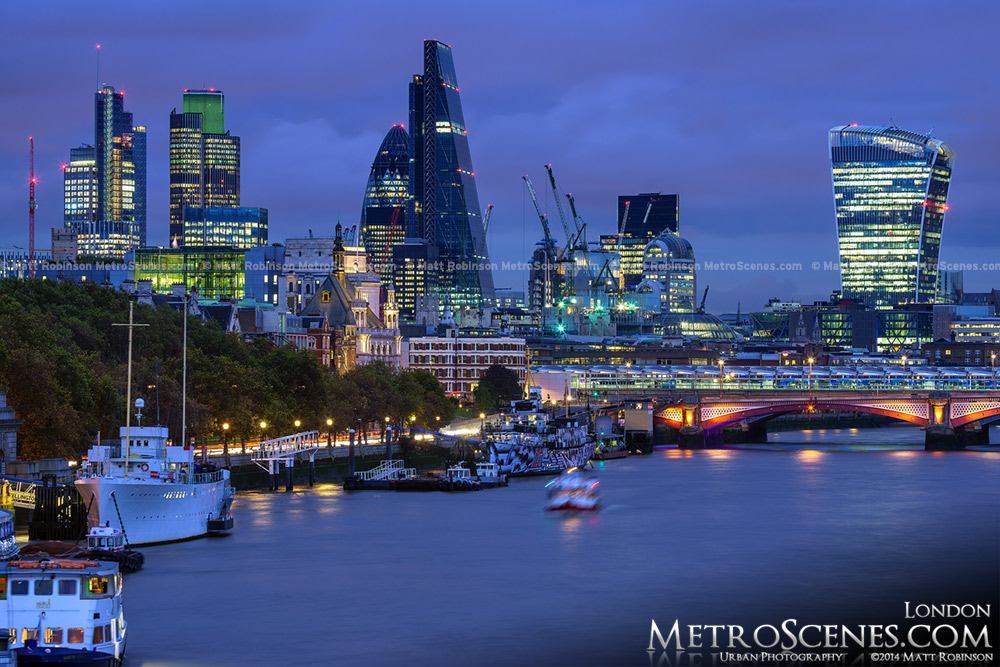 The Leadenhall Building at night with the City of London