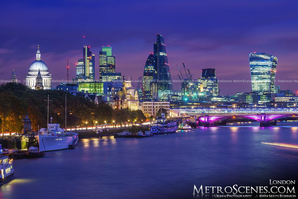 Waterloo Bridge view of The City of London at dusk