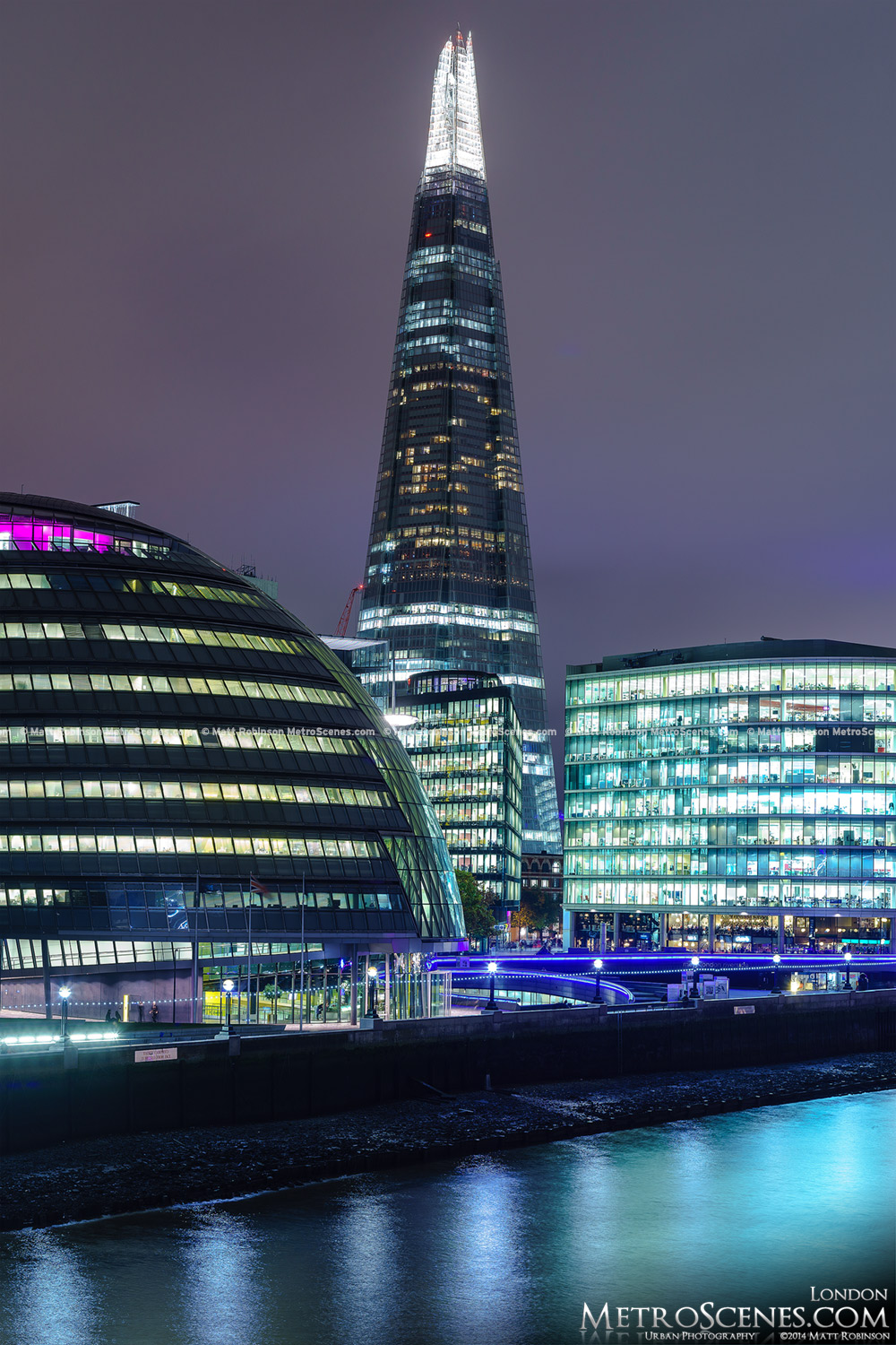 London's The Shard and City Hall at night from Tower Bridge