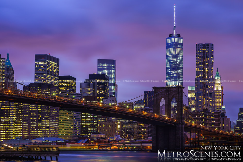 Night time DUMBO View of Lower Manhattan Skyline with the Brooklyn Bridge and One World Trade Center
