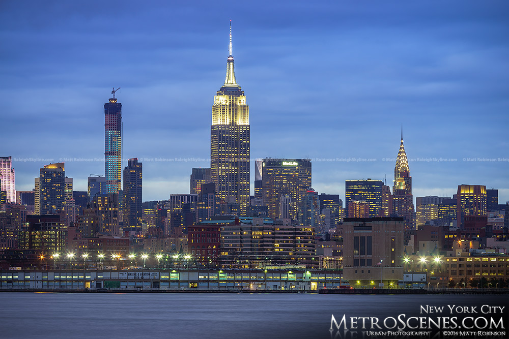Empire State Building at night with 432 Park Challenging
