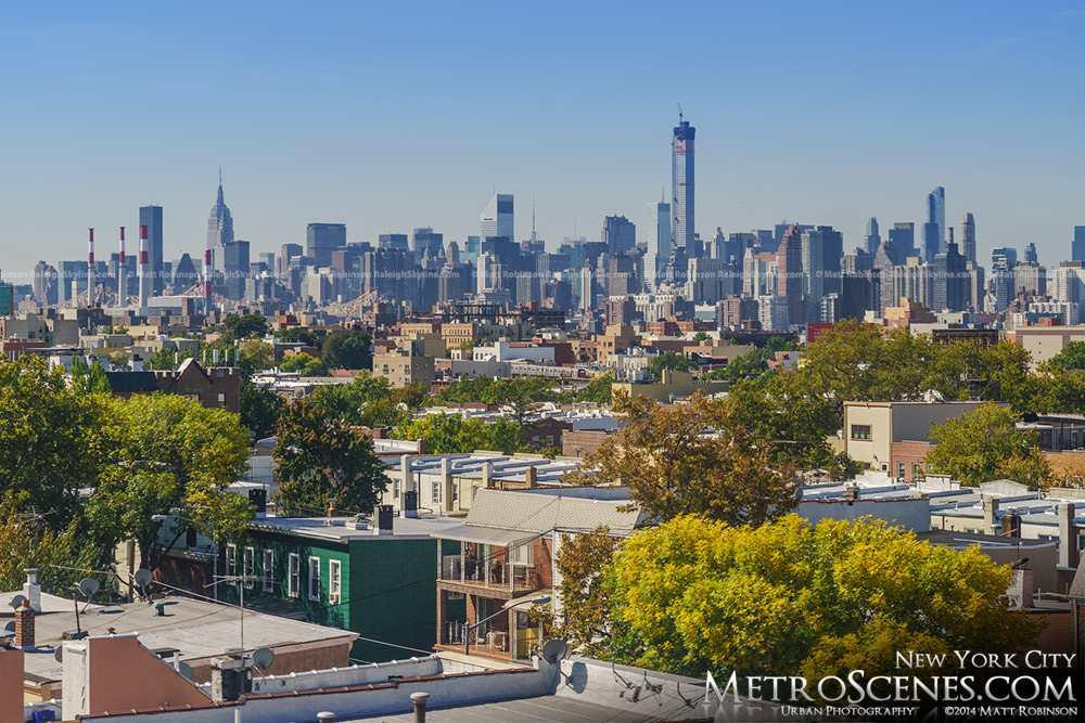 Midtown Manhattan Skyline Rises over Queens with Autumn fall colors in New York