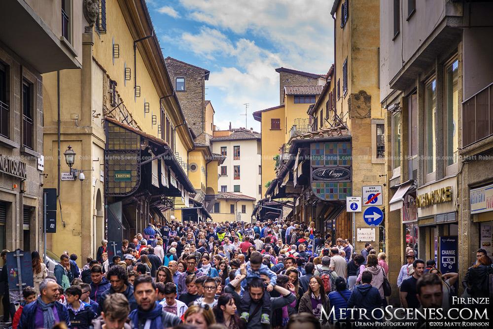 Crowds of pedestrians on Ponte Vecchio