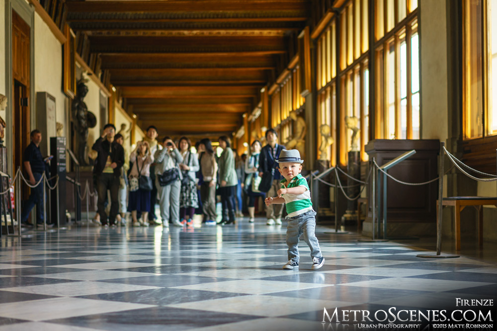 Baby in Uffizi Gallery Hallway