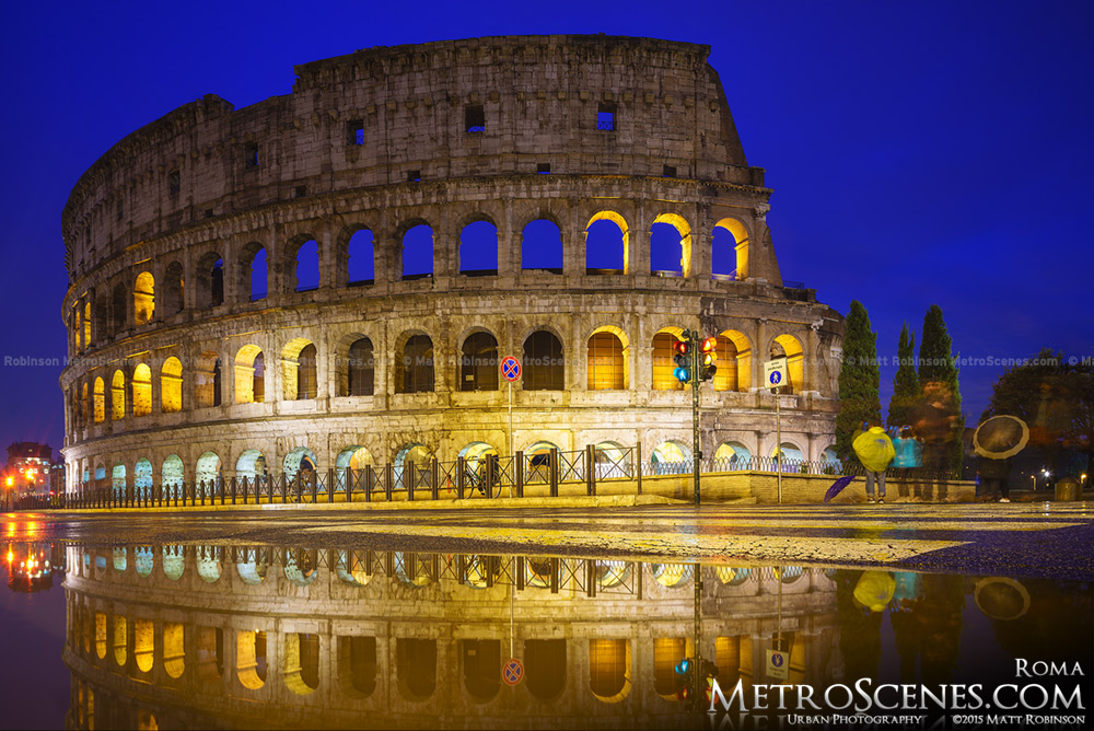 A puddle reflects the ancient Roman Colosseum