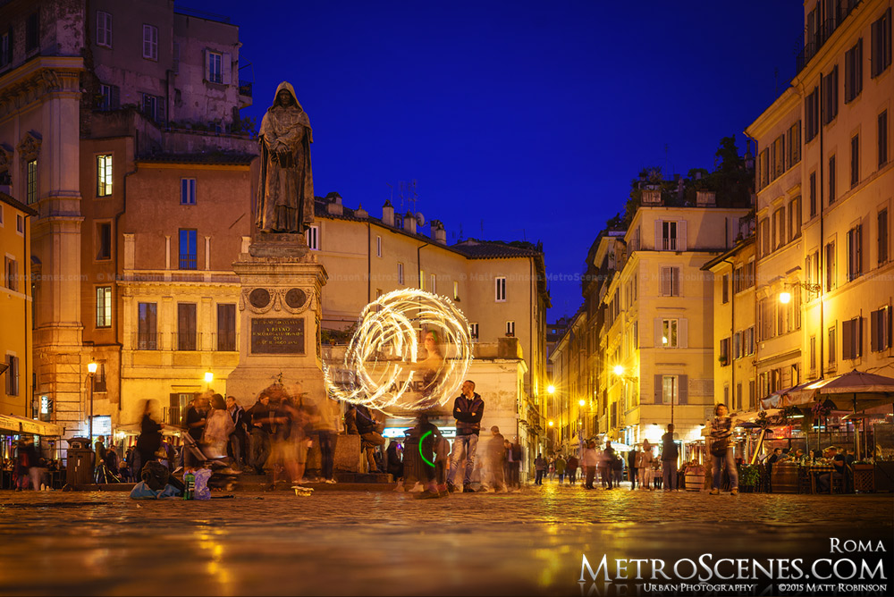 Fire dancer at Campo dei Fiori at dusk