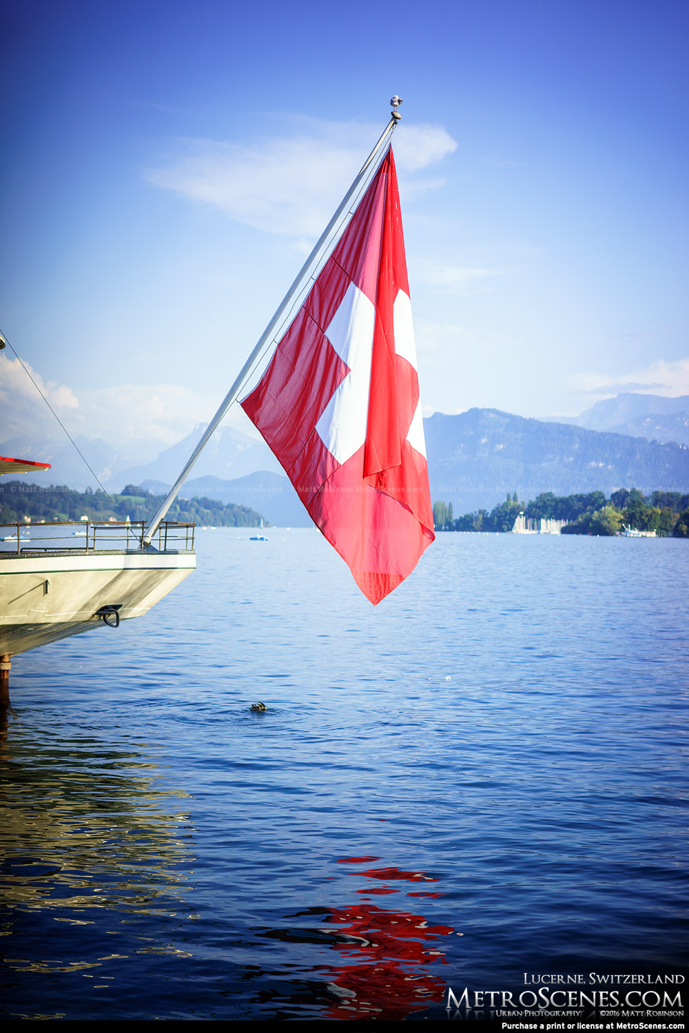 Swiss Flag on the bow of a ship on Lake Lucerne