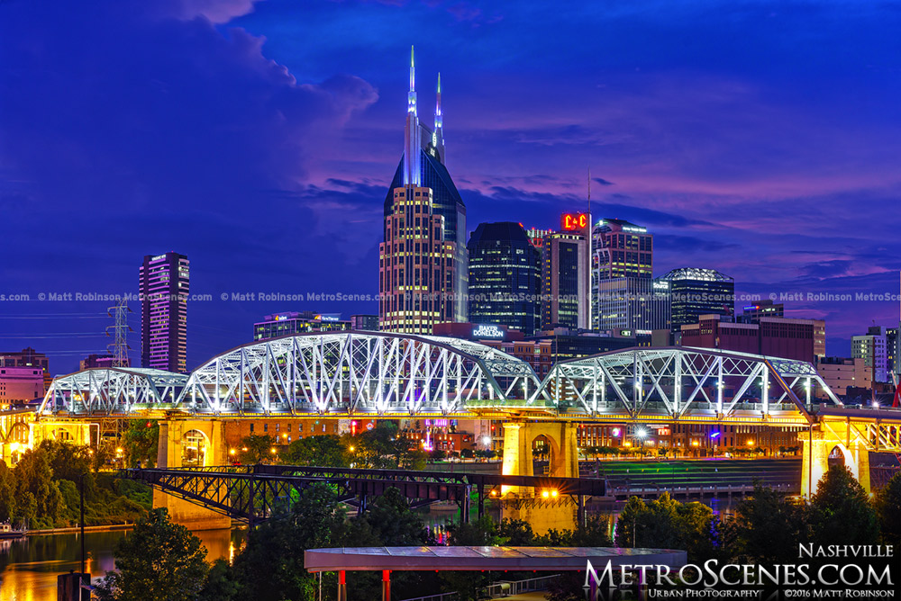 Batman Building in Nashville with the John Seigenthaler Pedestrian Bridge at night
