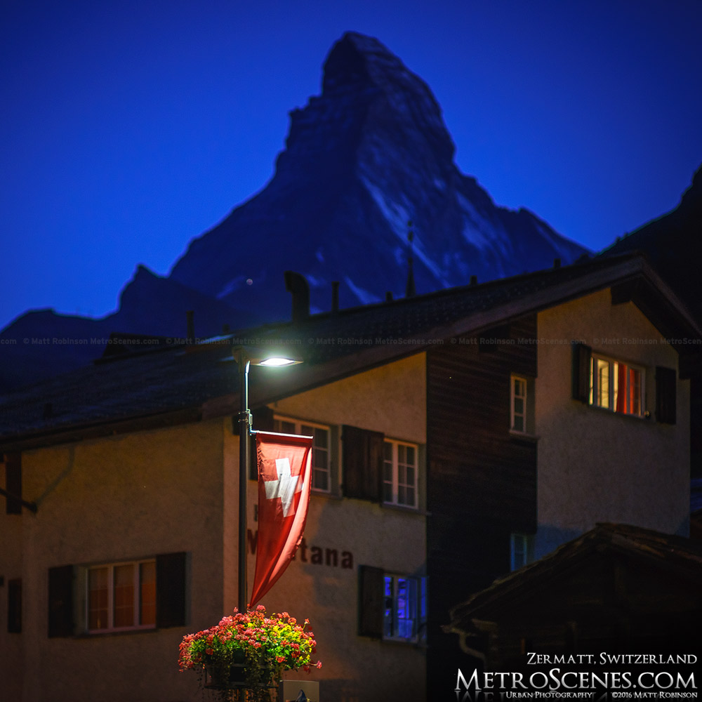Swiss flag and the Matterhorn at night