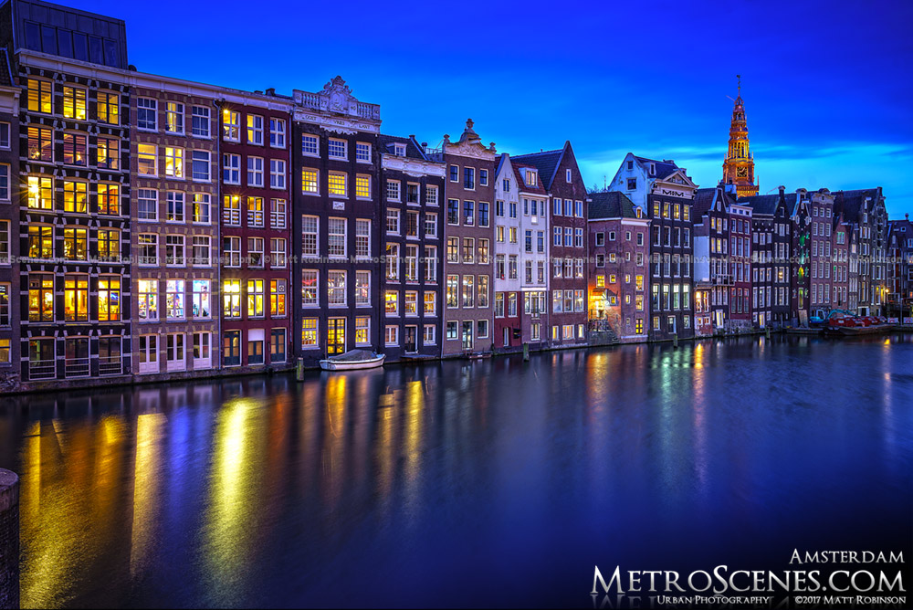 Damrak Canal with Amsterdam Houses with Oude Kerk