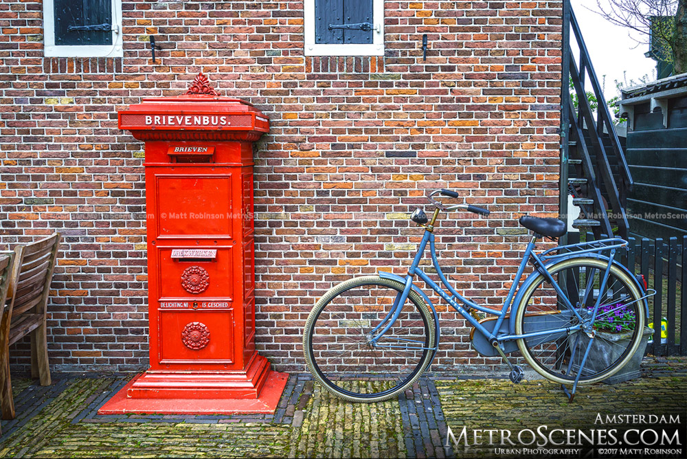 Old Brievenbus post with bicycle