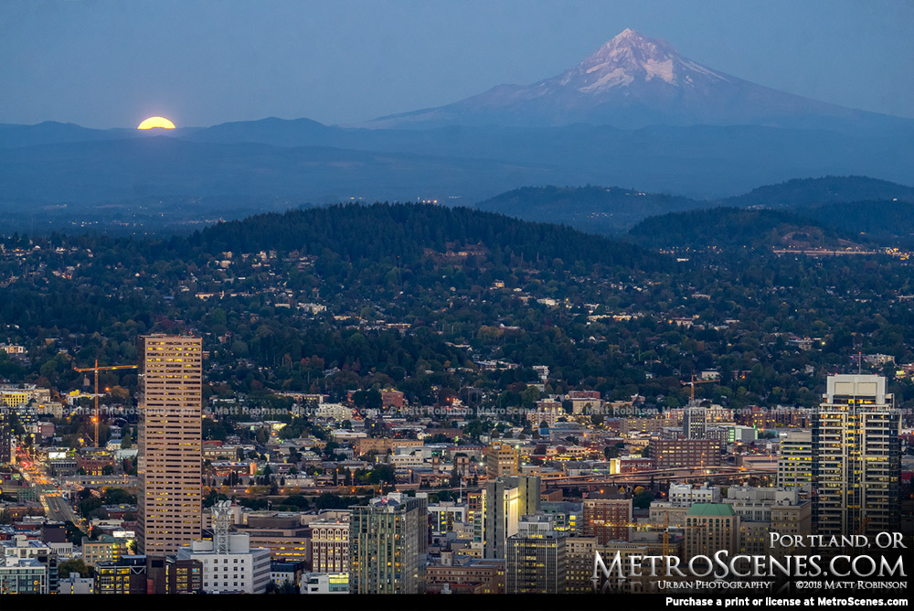 Moon begins to rise over downtown Portland, Oregon and Mt. Hood