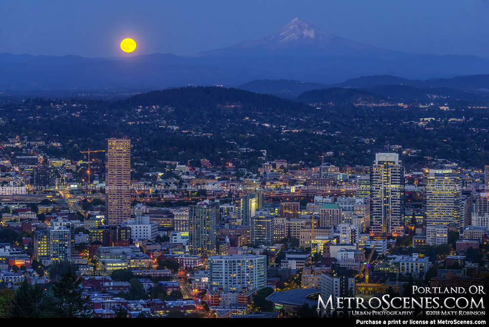 Full Moon rises behind the Portland Skyline and Mt. Hood