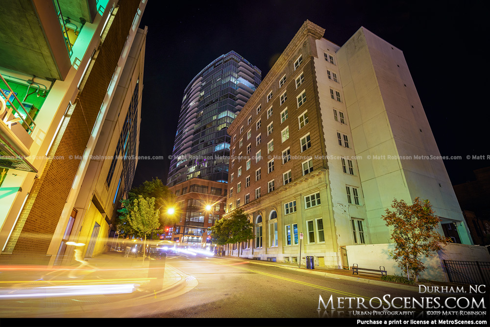 Looking up One City Center from Corcoran Street at night in Durham