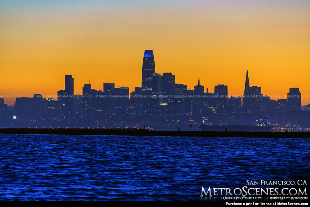 Golden sunset behind downtown San Francisco Skyline
