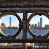 Boston seen through Charles River railing